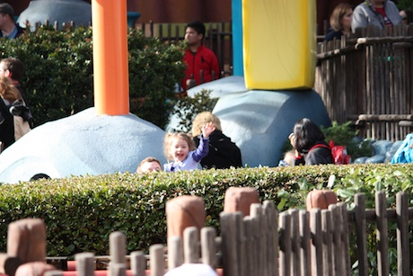 Maile and Daddy in line for Maile's very first roller coaster ride...