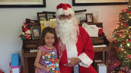 Santa called Maile's name first and she jumped right up to see him - no more running for cover like years gone by...