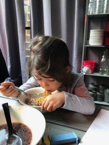 Lauren enjoying some seriously good ramen at Ivan Ramen