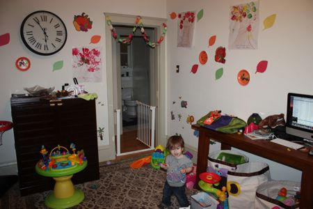 Maile in her new art gallery (a.k.a. our living room ... err Maile's play area)