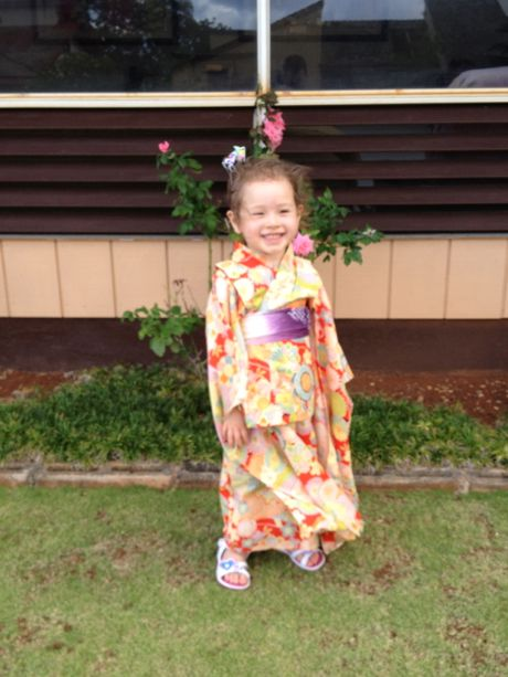 Maile dressed up all fancy in one of mommy's old kimonos. She felt like a princess and, boy, did she look the part!