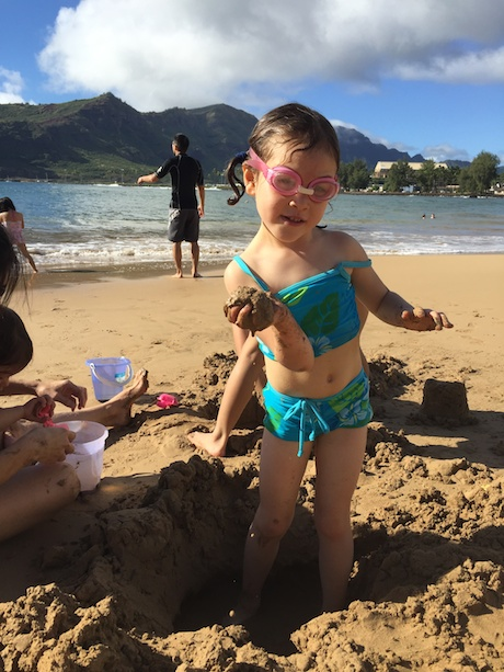 Maile loves playing in the sand at the beach...