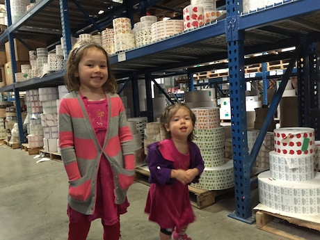 Maile and Lauren on the factory floor taking it all in and contemplating where to store all their new stickers...