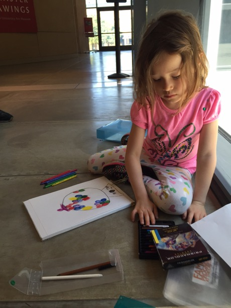 Maile working on her first piece of art for the day - a very colorful gumball machine.