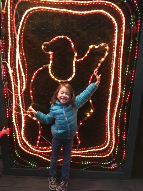 Maile Girl striking a pose with one of the many decorations...