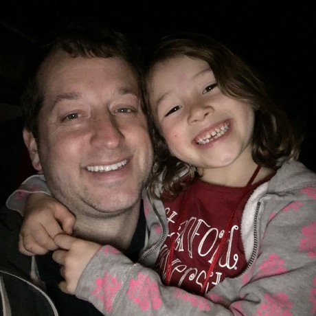 Daddy and Maile - all smiles after a fun time at the parade :)